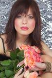 Das Mädchen und die Rosen Stockfotos