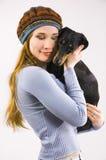 Das Mädchen und ein Hund Lizenzfreies Stockbild