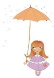 Das Mädchen unter einem Regenschirm Lizenzfreies Stockfoto