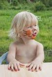 Das Mädchen von 3 Jahren mit einem Make-up Lizenzfreie Stockbilder