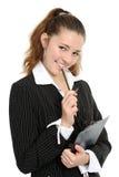 Das Mädchenlächeln, in den Händen hält eine mechanische Feder an Stockfotos