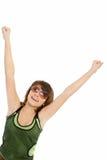 das Mädchenspringen der Freude über einem weißen Hintergrund Lizenzfreie Stockbilder