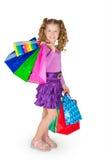 Das Mädchen hält viele Pakete an Stockfotos