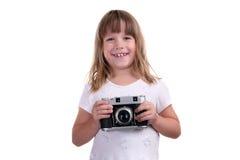 Das Mädchen mit der Kamera in den Händen Stockbilder