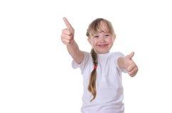 Das Mädchen zeigt eine Klasse Lizenzfreie Stockfotos