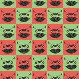 Das nahtlose karierte Hauptmuster der netten Katze in den grünen und rosa Farben Stockfoto