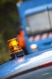 Das orange Blitzen und die Drehleuchte auf die Oberseite hält Fahrzeug instand Lizenzfreie Stockfotografie