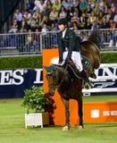 Das Pferd springend - Cian O'Connor Lizenzfreie Stockfotos