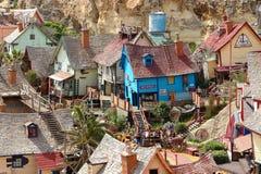 Das ` Popeye-Dorf` und -touristen Stockbild