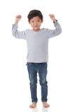 Das Porträt des Jungen herein stehend jubeln oben Stimmung zu stockfotografie