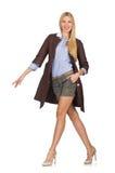 Das recht junge Modell in der braunen Jacke lokalisiert auf Weiß Lizenzfreies Stockbild