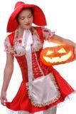 Das Rotkäppchen mit Halloween-Kürbis Lizenzfreies Stockbild