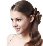 Das schöne junge Mädchen, das im Studio aufwirft Lizenzfreies Stockbild
