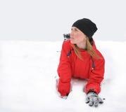 Das schöne Mädchen auf einem Schnee Stockbild