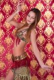 Das schöne Mädchen in einem orientalischen Kleid Stockfotos