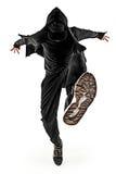 Das Schattenbild von einem männlichen Breakdancertanzen des Hip-Hop auf weißem Hintergrund Stockbild