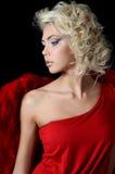 Das schöne Mädchen in einer Klage eines roten Engels Lizenzfreies Stockbild