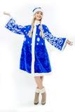 Das Schnee-Mädchen im blauen Weihnachtskostüm Stockfotos
