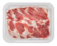 Das Schweinefleisch umrandet im Kasten, der auf weißem Hintergrund lokalisiert wird Lizenzfreie Stockfotos