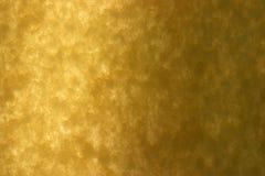 Das spezielle aufbereitete gelbe angehaltene Papier leuchtete mit Tageslicht Lizenzfreie Stockfotografie