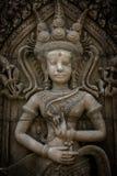 Das Steingesicht des Khmerkönigs auf der Wand des Tempels, Stockfoto