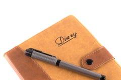 Das Tagebuch-Buch mit dem Stift Stockfotografie
