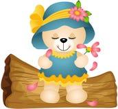 Das Teddybärspielen liebt mich nicht mit den Blumenblumenblättern Lizenzfreies Stockfoto