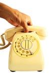 Das Telefon aufheben. Stockfotografie