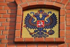 Das Wappen in der der Kreml-Wand Stockbild