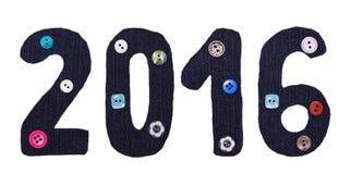 Das Weihnachten vom Gewebe und der Knopf bilden sich von den Aufschriften, 2016 Zahlen Stockfoto