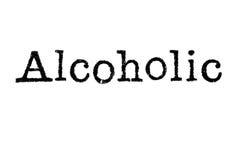 Das Wort ` alkoholische ` von einer Schreibmaschine auf Weiß Lizenzfreie Stockfotos