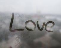 Das Wort auf einem Fenster Stockfotografie
