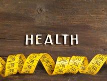 Das Wort der Gesundheit auf Holz und messender Art Stockfoto