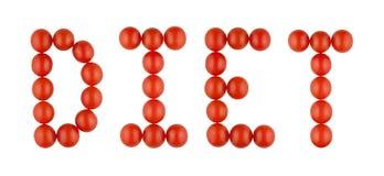 Das Wort DIÄT gemacht von den roten Tomaten auf dem weißen Hintergrund lizenzfreies stockfoto