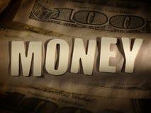 Das Wort Geld auf Papierhintergrund stockfotos