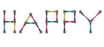 Das Wort GLÜCKLICH von farbigen Stöcken und von Bällen, Mehrfarbenelemente des magnetischen Erbauers Wiedergabe 3d lizenzfreie abbildung