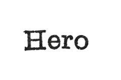 Das Wort ` Held ` von einer Schreibmaschine auf Weiß Stockbilder