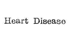 Das Wort ` Herz-Krankheit ` von einer Schreibmaschine auf Weiß Lizenzfreies Stockfoto