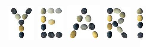 Das Wort Jahr! gemacht von den Kieseln Stockfotos
