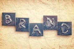 Das Wort MARKE gemacht von den Metallbuchstaben Stockfotografie