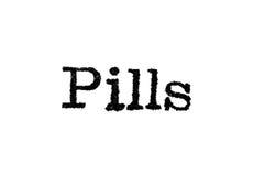 Das Wort ` Pillen ` von einer Schreibmaschine auf Weiß Lizenzfreies Stockfoto