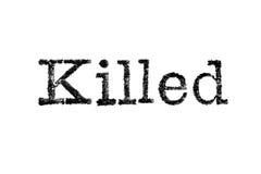 Das Wort ` tötete ` von einer Schreibmaschine auf Weiß Lizenzfreies Stockfoto