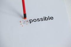 Das Wort unmöglich zu möglichem mit einem Bleistiftradiergummi ändern Lizenzfreies Stockbild