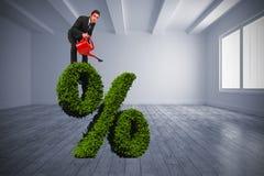 Das zusammengesetzte Bild des Geschäftsmannes wässernd mit Rot kann Stockbilder