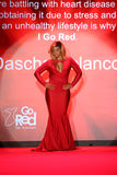 Dascha Polanco walks the runway at the Go Red For Women Red Dress Collection 2015 Royalty Free Stock Photos