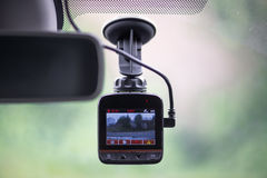 Dash camera. In car installed on the window Royalty Free Stock Photos