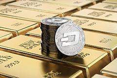 Dash coins laying on stacked gold bars gold ingots rendered with shallow depth of field. Concept of highly desirable cryptocurre Stock Photo