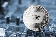 Dash crypto currency silver coin mining computer background. Dash silver coin on blue motherboard chip digital mining computer hardware crypto currency financial stock photos