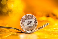 Dash cryptocurrency fork concept. On a golden background Royalty Free Stock Photography