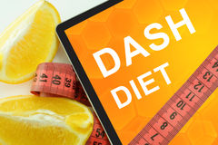 Dash diet on tablet. Fat lost concept stock photos